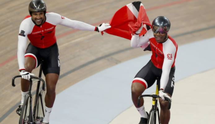 Photo: Trinidad and Tobago cyclists Njisane Phillip (left) and Nicholas Paul celebrate after helping Team TTO cop gold in the Men's Team Sprint final at the Pan American Games in Lima, Peru on 1 August 2019. (Copyright AP Photo/Fernando Llano/Wired868)