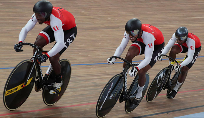 T&T's cyclists  Keron Bramble, Njisane Phillip and Nicholas Paul competing in the men's team sprint qualifying round at the Pan American Games in Lima, Peru, yesterday. (AP) @Fernando Llano