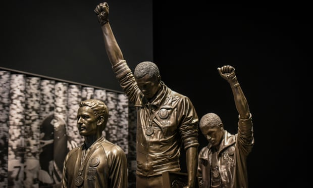 A statue depicting US athletes Tommie Smith and John Carlos as they raised gloved fists during the medal ceremony at the 1968 Olympics is housed at the Smithsonian Institute's National Museum of African American History & Culture. Photograph: The Washington Post/Getty Images