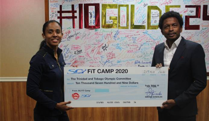 Fitness Instructor Extraordinaire Simone Gonzales of the Fitness Center Ltd delivers proceeds from her recently concluded Fitness Camp, to TTOC president, Mr. Brian Lewis.
